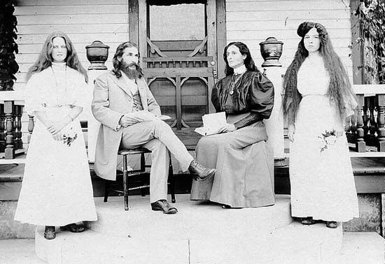 Benjamin and Mary Purnell with two Israelite school girls on Bethlehem porch. 1909