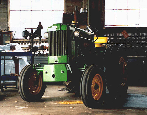 1930 mechanics garage still in service today. 1940s John Deere tractor with nearby 1920s drill press.