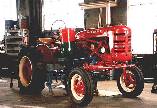 1940s International Farmall tractor with fertilizer attachment and cultivators mounted. Fully restored.