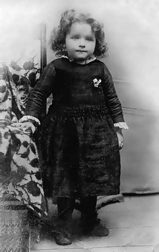 Hettie Purnell as a child. Hettie would die a tragic death several weeks after her 16th birthday, in Fostoria, Ohio. Just several weeks ahead of their departure date for a new home in Benton Harbor, Michigan, the death of their daughter brought a solemn trying hour to the joy of their intended plans in journeying to Benton Harbor, and a final established base for their new-born church. Hettie died on her first day at work in a fire works factory in Fostoria. An explosion and subsequent fire destroyed the structure, killing all inside.