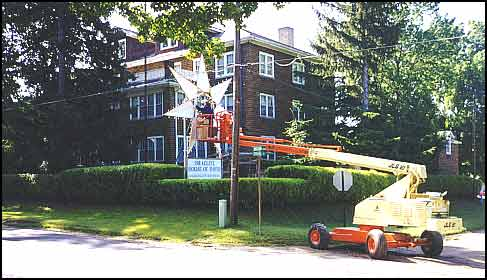 Colony electrician working on the Star lighting at the Administration building, 1999.