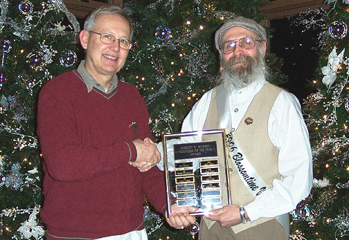 This year the award was presented to Ron Taylor for his many hours volunteering this past year. Ron has been a volunteer for Blossomtime for many years in arranging and hosting the House of David Echoes Base Ball Club in the Grand Floral Parade and the vintage baseball games with the Blossom Queens after the blessing of the blossoms and during fair week in August.